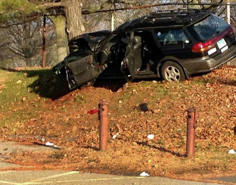 Police say that the driver of a car that slammed into a tree on Boston Ave. near Seaview Ave. in Bridgeport, Conn on Thursday, Dec. 4, 2014, has died. Photo: Frank Juliano / Connecticut Post