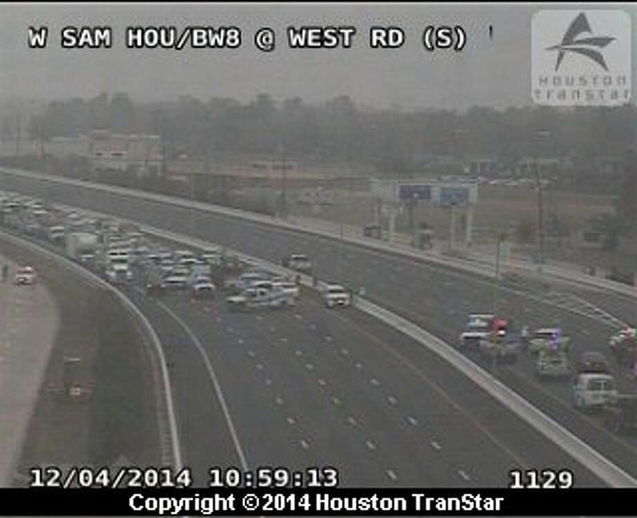Portions of the Sam Houston Tollway were shut down in west Houston after a power line fell onto the road. Photo: Houston TranStar