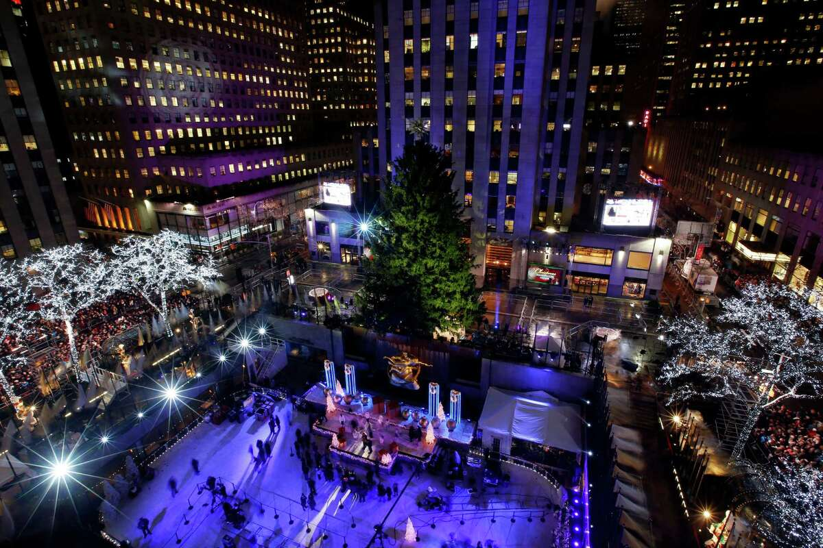 The Rockefeller Center Christmas tree is on display before a lighting ceremony, Wednesday, Dec. 3, 2014, in New York. Weighing in at approximately 13 tons, the 85-foot tall, 90-year-old Norway Spruce will be adorned with 45,000 energy efficient LED lights. (AP Photo/Jason DeCrow) ORG XMIT: NYJD101