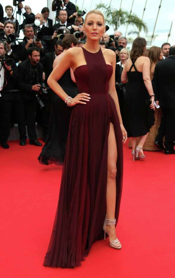 """FILE - In this May 14, 2014 file photo, American actress Blake Lively poses for photographers on the red carpet during the opening ceremony and the screening of """"Grace of Monaco"""" at the 67th international film festival, Cannes, southern France. Marsala, the wine-influenced, red-kissed color of 2015, was chosen by Pantone. Pantone's yearly picks can herald a marked presence of a color in fashion, beauty, housewares, home design and consumer packaging, though some years the influence is stronger than others. (Photo by Joel Ryan/Invision/AP, File) Photo: Joel Ryan, Joel Ryan/Invision/AP / Invision"""
