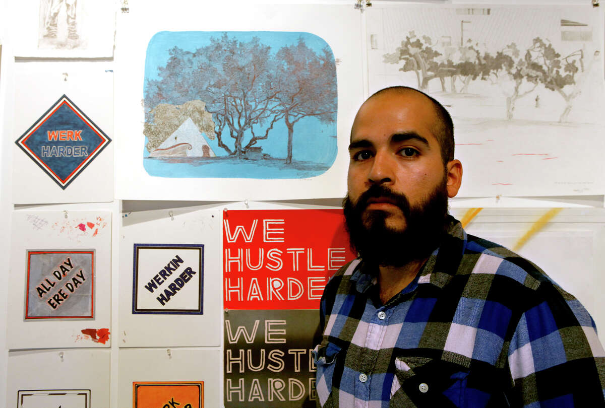 """Small paintings, prints and drawings adorn a wall in Terminal 136 at the Blue Star Art Complex where UTSA student Raul Gonzalez has installed his MFA thesis exhibition titled """"Werk / In the Zone."""""""