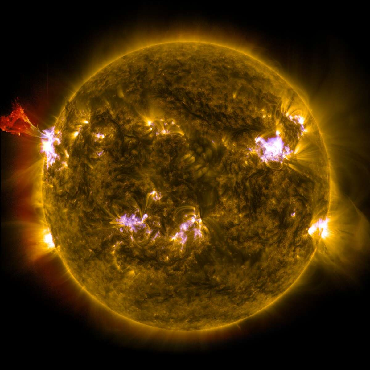 A burst of solar material leaps off the left side of the sun in what's known as a prominence eruption. This image combines three images from NASA's Solar Dynamics Observatory captured on May 3, 2013, at 1:45 pm EDT, just as an M-class solar flare from the same region was subsiding. The images include light from the 131-, 171- and 304-angstrom wavelengths.