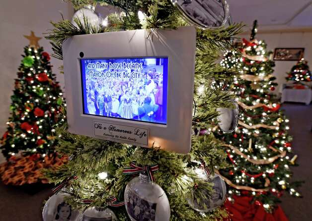 An innovative tree by the Kaddo family shows some of the different trees displayed during the annual Festival of Trees show Thursday morning, Dec. 4, 2014, at the Schenectady County Historical Society in Schenectady, N.Y.  The show features a large number of unusual and traditionally decorated trees. It runs through Dec. 14 and is co-sponsored by YWCA of Northeastern NY.  (Skip Dickstein/Times Union) Photo: SKIP DICKSTEIN / 00029664A