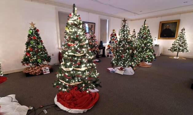 Beautifully decorated Christmas trees are on display during the annual Festival of Trees show Thursday morning, Dec. 4, 2014, at the Schenectady County Historical Society in Schenectady, N.Y.  The show features a large number of unusual and traditionally decorated trees. It runs through Dec. 14 and is co-sponsored by YWCA of Northeastern NY.  (Skip Dickstein/Times Union) Photo: SKIP DICKSTEIN / 00029664A