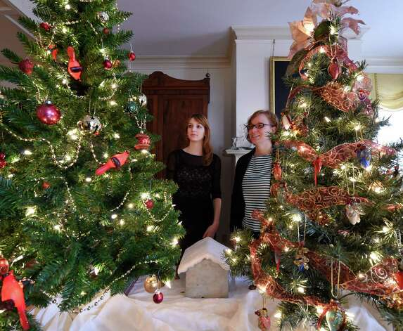 Schenectady County Historical Society curator Mary Zawaki, left, and assistant curator Kaitlin Morton-Bently, right, look at some of the beautifully decorated Christmas trees in the annual Festival of Trees show Thursday morning, Dec. 4, 2014, at the Schenectady County Historical Society in Schenectady, N.Y. The show features a large number of unusual and traditionally decorated trees. It runs through Dec. 14 and is co-sponsored by YWCA of Northeastern NY.  (Skip Dickstein/Times Union) Photo: SKIP DICKSTEIN / 00029664A