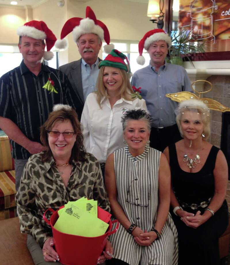 Getting in the spirit and looking forward to the 2014 CASA Home Tour are, from left, front row: Cynthia Barratt, Pat Somers and Vickie Looney; back row: Mark Magee, Denny Adelung, Brigit Engleman and Jim McClellan. Photo: Child Advocates Of Fort Bend