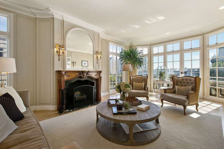 The living room features coffered wall panels and divided light windows.Click here to see what else is currently on the market in Pac Heights. Photo: Open Homes Photography