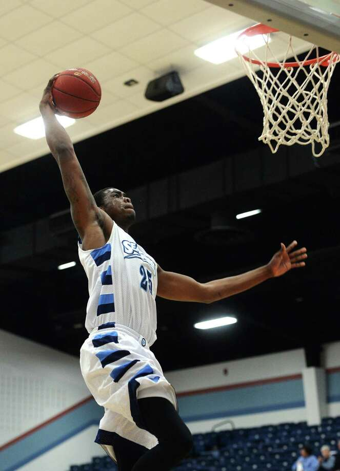The Seahawks' Darius Paul, No. 25, goes up for a dunk during Wednesday's game against Kilgore College. The Lamar State College-Port Arthur Seahawks hosted the Kilgore College Rangers at the Carl Parker Center on Wednesday.  Photo taken Wednesday 12/3/14  Jake Daniels/The Enterprise Photo: Jake Daniels / ©2014 The Beaumont Enterprise/Jake Daniels