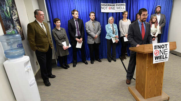 Issac Silberman-Gorn, community organizer with Citizen Action of New York based in Binghamton joins with other anti-fracking activists in the Legislative Office building Wednesday morning Dec. 3, 2014,  in Albany, N.Y.  calling for Governor Cuomo have a three to five year moratorium on fracking.     (Skip Dickstein/Times Union) Photo: SKIP DICKSTEIN, ALBANY TIMES UNION / 00029721A