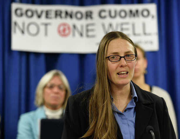 Julia Walsh of Frack Action joins with other anti-fracking activists in calling for Gov. Cuomo to impose a three to five year moratorium on fracking Wednesday morning, Dec. 3, 2014, during a press conference at the Legislative Office Building in Albany, N.Y.      (Skip Dickstein/Times Union) Photo: SKIP DICKSTEIN, ALBANY TIMES UNION / 00029721A