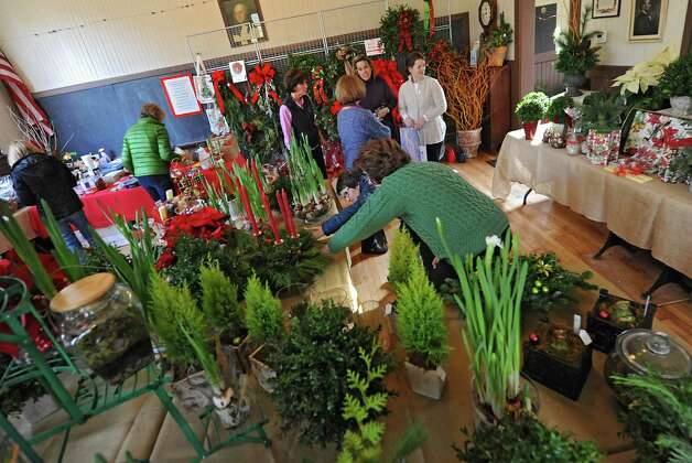Members of the Fort Orange Garden Club set up for their Holiday Greens Sale Thursday, Dec. 4, 2014, as they set up for their Holiday Greens Sale which takes place this Friday and Saturday at the Pruyn House Schoolhouse in Colonie, N.Y. (Lori Van Buren / Times Union) Photo: Lori Van Buren / 00029675A