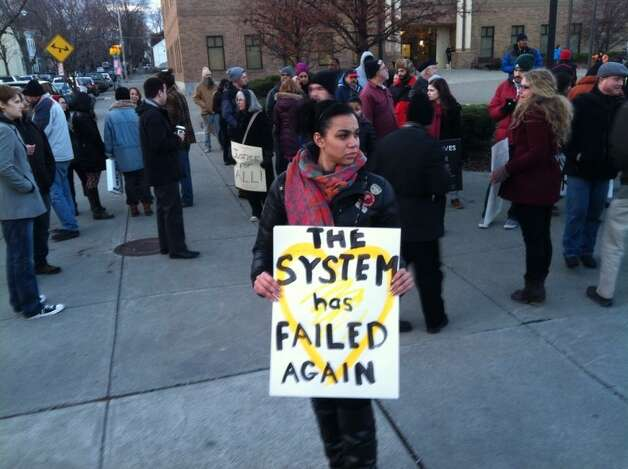 Protesters gather on before Albany Police Headquarters on Henry Johnson Boulevard for a rally on Thursday, Dec. 4, 2014, in Albany, NY. (Michael P. FarrellTimes Union)