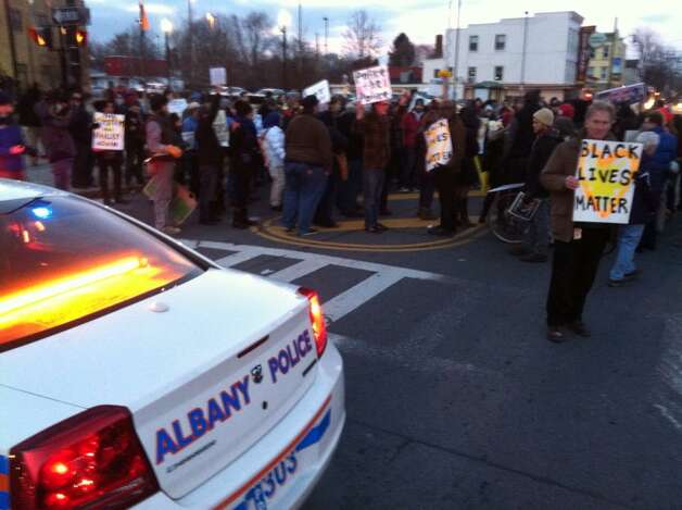 Protesters block traffic on Henry Johnson Boulevard for a rally on Thursday, Dec. 4, 2014, in Albany, NY. (Michael P. Farrell/Times Union)