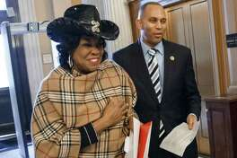 Rep. Frederica Wilson, D-Fla. (left),and Rep. Hakeem Jeffries, D-N.Y., arrive for votes on Capitol Hill, where the House voted to rebuke President Obama's recent executive order on immigration.