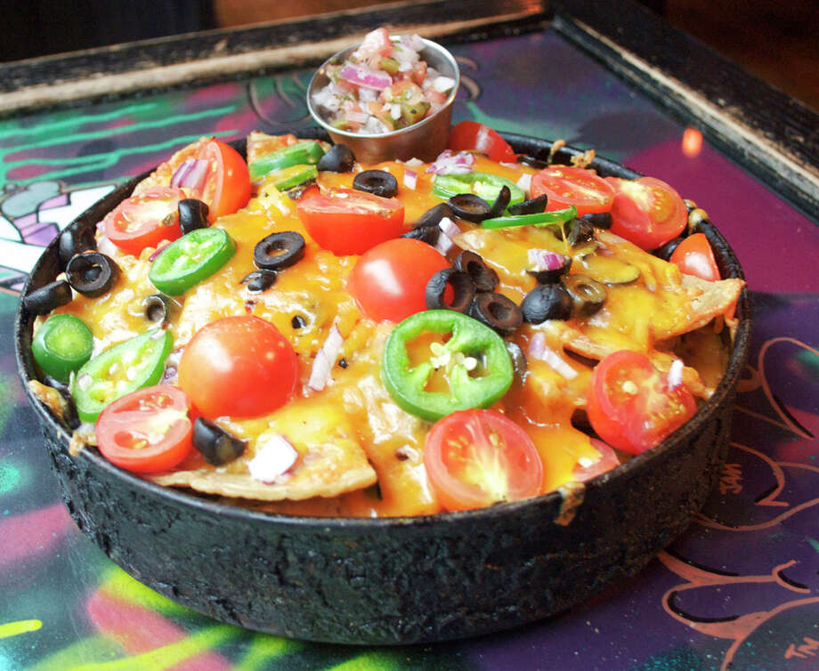 How about this for Texas in a pizzeria? This deep dish nacho special is just one lone star item on the menu at the new Gino's East pizzeria opening in the Woodlands December 11. Photo: Gino's East
