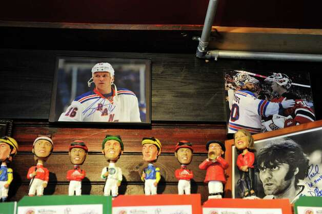 A view of some of the sports memorabilia on display inside The Barrel House on Tuesday, Dec. 2, 2014, in Saratoga Springs, N.Y.  (Paul Buckowski / Times Union) Photo: Paul Buckowski / 00029690A