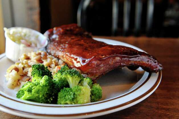 A half-rack of pork ribs with a side of broccoli and Hoppin' John at The Barrel House on Tuesday, Dec. 2, 2014, in Saratoga Springs, N.Y.  (Paul Buckowski / Times Union) Photo: Paul Buckowski / 00029690A