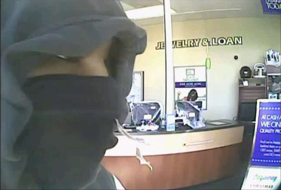 On Oct. 30, 2104, two masked men entered a business located in the 500 block of Greens Road, and smashed through a jewelry display case with a sledgehammer before making off with the loot inside. Photo: Crime Stoppers Of Houston
