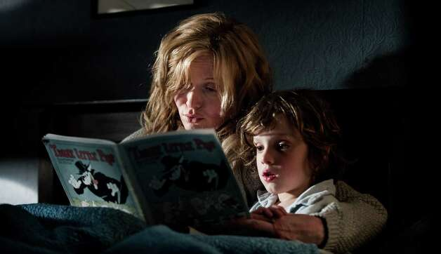 """The Babadook""IMDb: 6.9/10Review by A.O. Scott: Book pages can't contain demonThree-and-a-half starsI was an easily frightened child, and nothing scared me more than certain picture books. Something about the static images, the simple words and the unseen menaces hidden between pages made books much more sinister than, say, movies, and quite a few volumes that now seem perfectly innocuous were banished from my bedroom shelves. I had forgotten about this youthful phobia until I saw ""The Babadook,"" the debut feature by Australian director Jennifer Kent. Or rather, until I came home from the screening, went to bed and woke up in the throes of the kind of nightmare that was the reason I had shunned those books in the first place. Photo: Handout, HO / TNS"