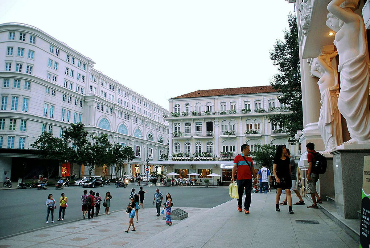 A plaza in front of the Saigon Opera House (front right) with the red roofed Hotel Continental Saigon nearby.