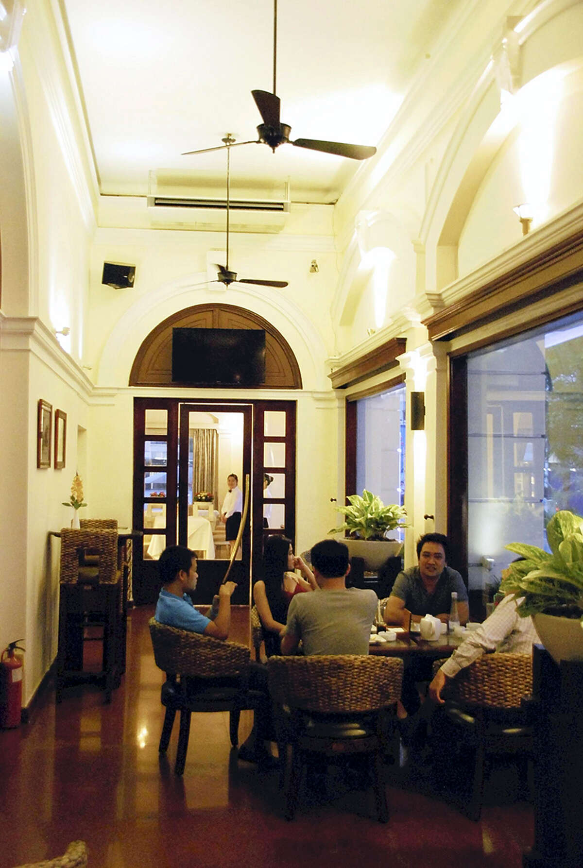 """A bar inside the Hotel Continental Saigon was depicted as a place to gather information in Graham Greene's novel """"The Quiet American."""""""