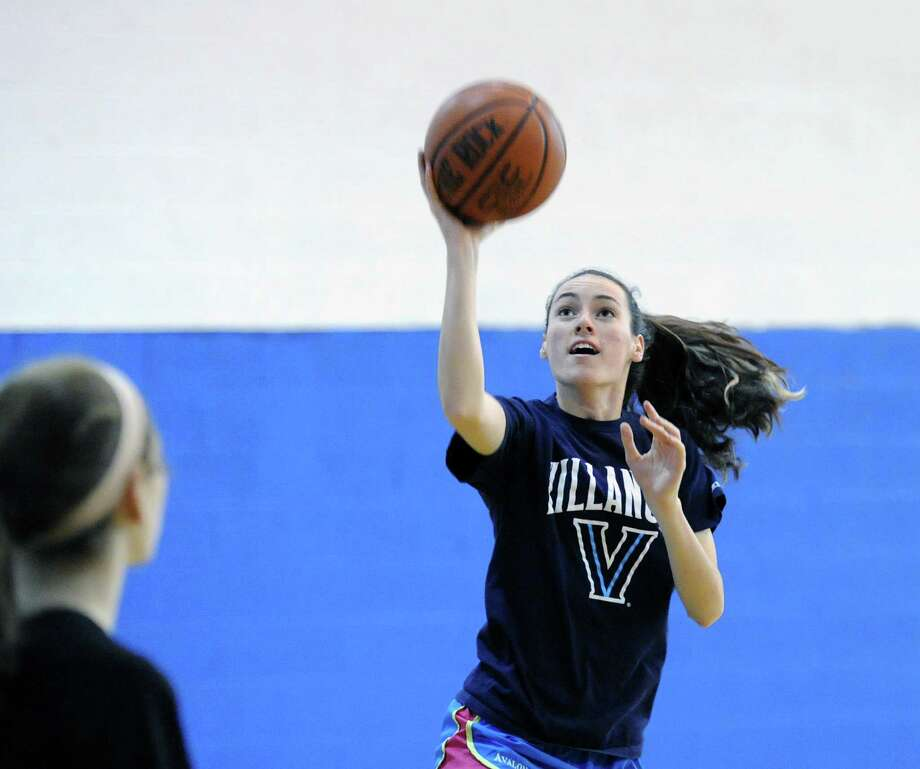 Claire O'Neill shoots during Convent of the Sacred Heart basketball practice at Purchase College, Purchase, N.Y., Thursday, Dec. 4, 2014. O'Neill is captain of the team. Photo: Bob Luckey / Greenwich Time