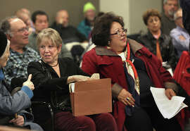 Kate Walker (left) and Sylvia Alvarez listen to other city retirees voice their concerns to board members at Wednesday's session.