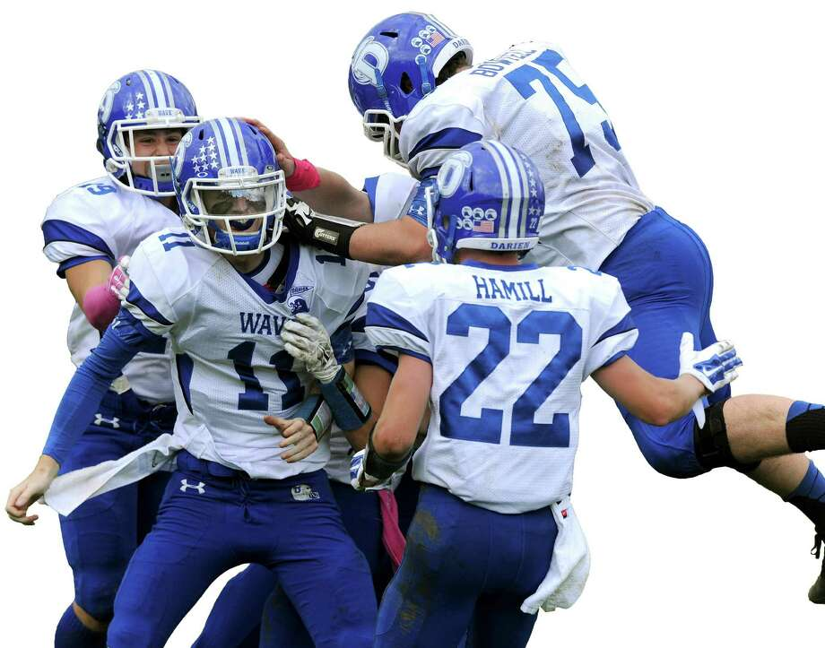 Darien players celebrate Timothy Graham's touchdown during Saturday's football game in Stamford, Conn., on October 18, 2014. Photo: Lindsay Perry / Stamford Advocate