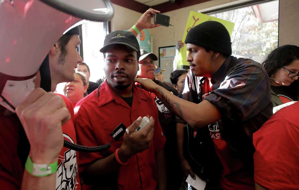 McDonald's fast-food worker Xavier Dillon was persuaded to leave his job and join the rally for higher wages during a protest occupying the McDonald's at 98th Avenue and International Boulevard in Oakland on Thursday.