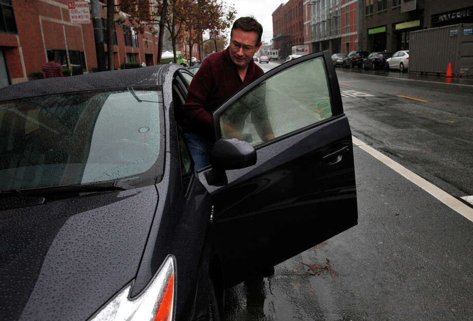 Michael Bendorf, whose car was in an accident, has new one that he got through Peers so he can keep driving for Lyft. Photo: Leah Millis / The Chronicle / ONLINE_YES
