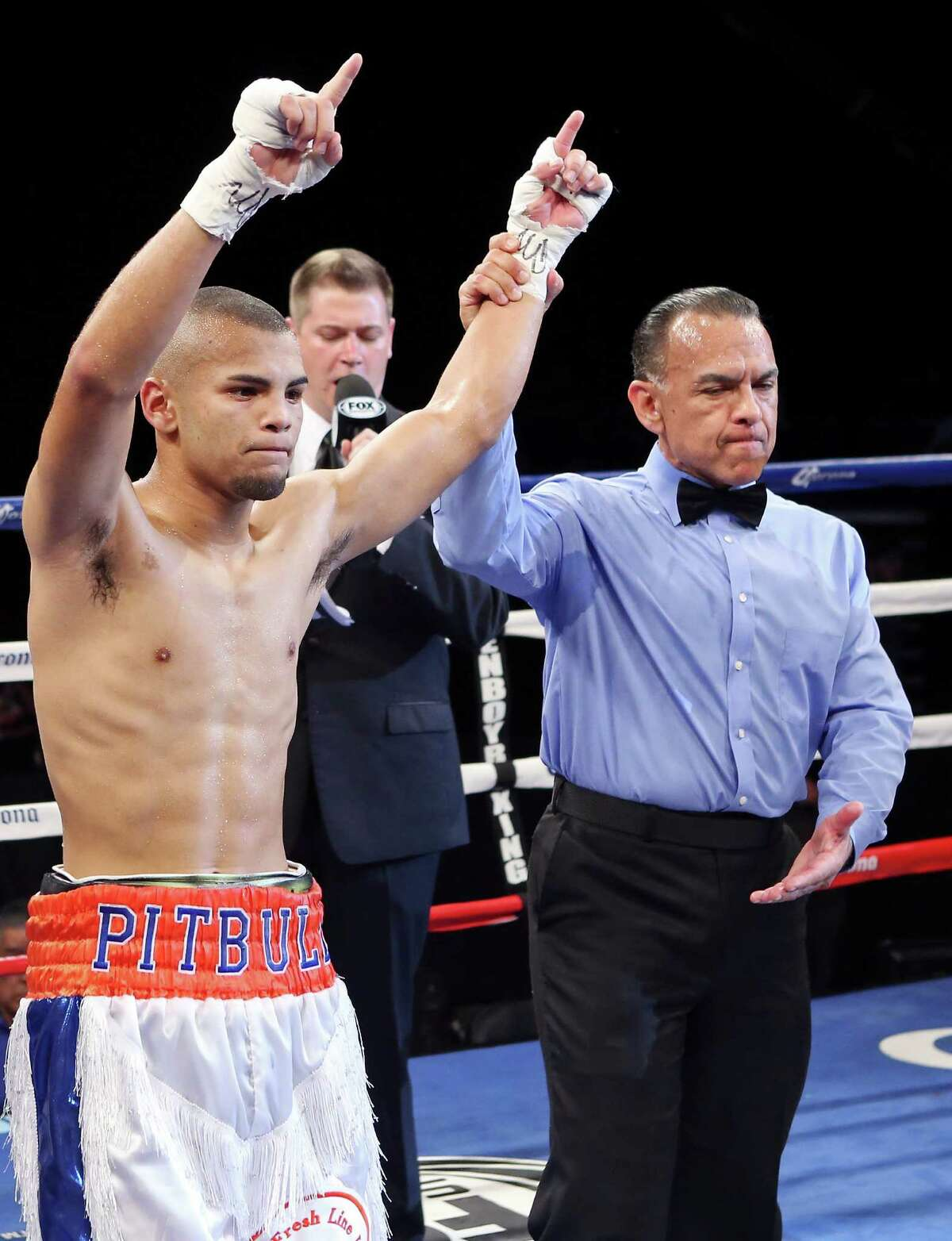Javier Rodriguez (left) celebrates his win over Manuel Rubalcava (not pictured) after their junior featherweight bout on April 18, 2014 at the Alamodome's Illusions Theater. Rodriguez won unanimous decision.