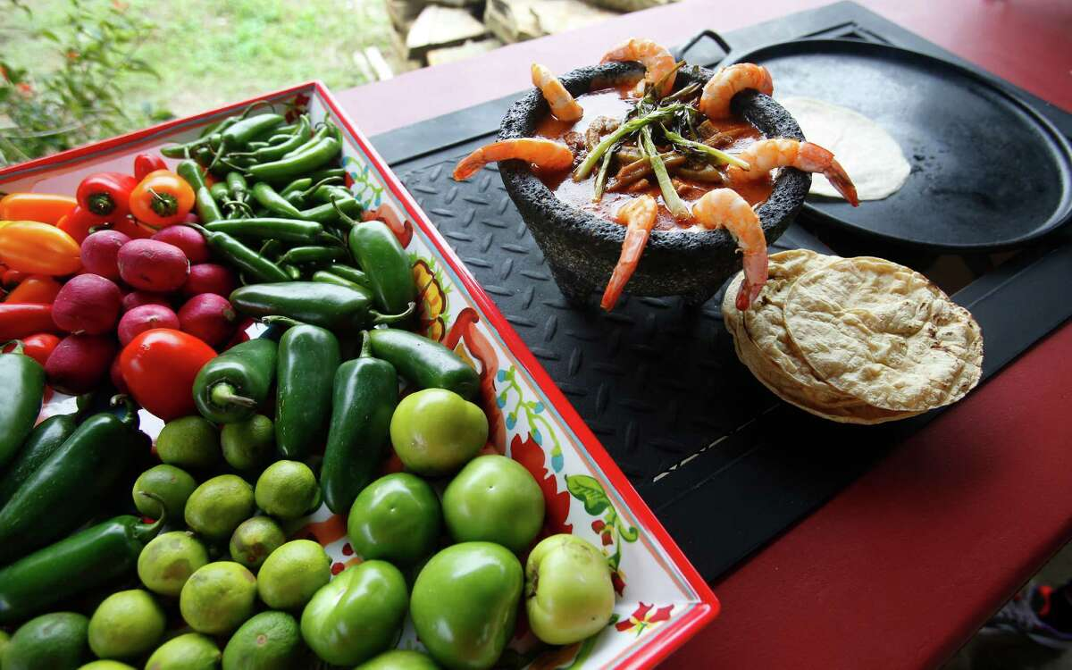 Ramon Lopez built a cabinet for a portable propane-fired burner for wife Laura's outdoor kitchen. Laura uses the burner for charring peppers and other vegetables so she doesn't smoke up the house.