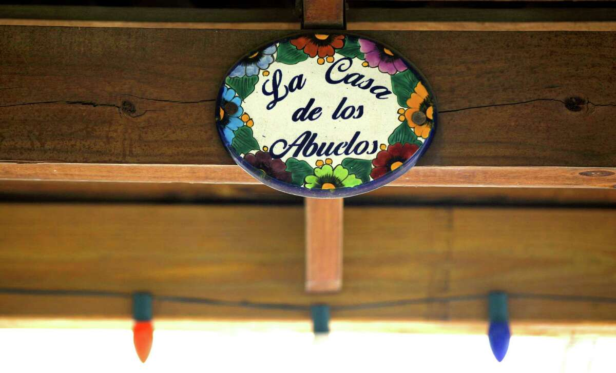 Small details personalize Ramon and Laura Lopez's outdoor kitchen at their home near New Braunfels.