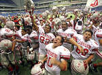 Judson players celebrate after winning the regional title against Reagan on Dec. 8, 2007, at the Alamodome.