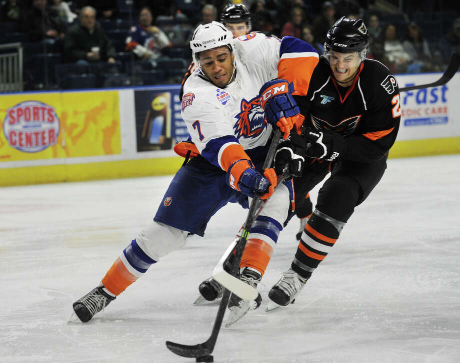 Sound Tiger Scooter Vaughan, left, races in on net defended by Adirondack defenseman Mark Alt in the 3rd period of the Soundtigers 5-4 AHL hockey win at the Webster Bank Arena in Bridgeport, Conn. on Sunday, March 16, 2014. Photo: Brian A. Pounds / Connecticut Post