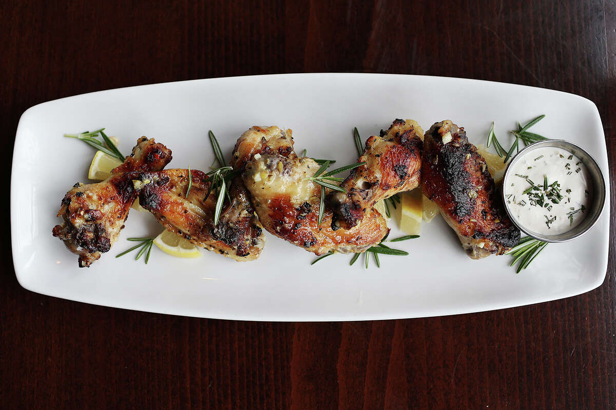 The Limoncello Chicken Wings antipasti are flavored with rosemary and citrus and served with a buttermilk-based sauce.