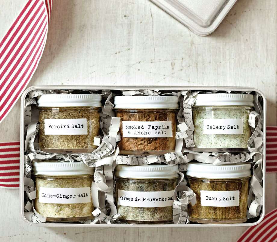 "Flavored salts, from the gift-ideas book ""Holiday Cheer,"" give your favorite cooks an array of salty flavors. Photo: Courtesy / ""Holiday Cheer"""