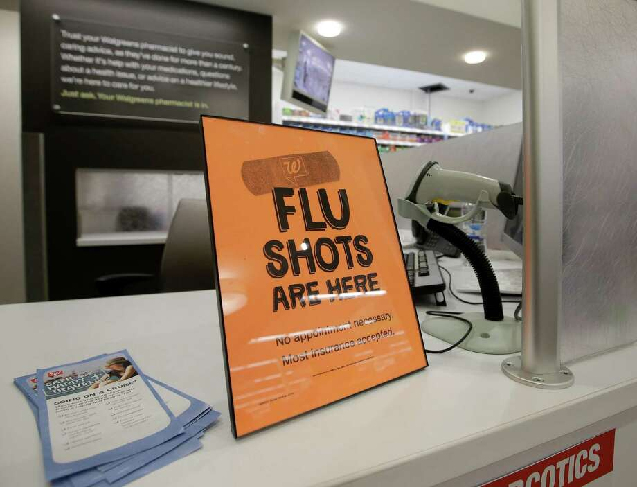 FILE - In this Sept. 16, 2014 file photo, a sign lets customers know they can get a flu shot in a Walgreen store in Indianapolis. The flu vaccine may not be very effective this winter, according to U.S. health officials who worry this may lead to more serious illnesses and deaths. The  Centers for Disease Control and Prevention issued an advisory to doctors about the situation Wednesday, Dec. 3, 2014. (AP Photo/Darron Cummings, File) Photo: Darron Cummings, STF / AP