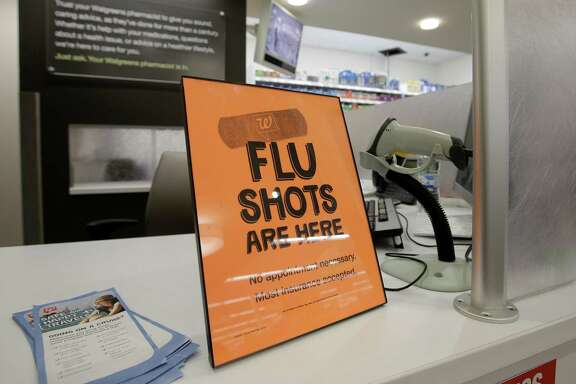 FILE - In this Sept. 16, 2014 file photo, a sign lets customers know they can get a flu shot in a Walgreen store in Indianapolis. The flu vaccine may not be very effective this winter, according to U.S. health officials who worry this may lead to more serious illnesses and deaths. The  Centers for Disease Control and Prevention issued an advisory to doctors about the situation Wednesday, Dec. 3, 2014. (AP Photo/Darron Cummings, File)