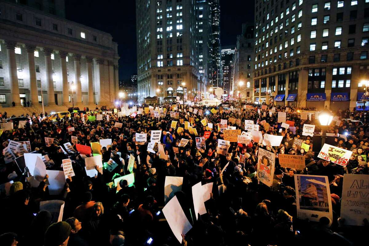 Protesters rally Thursday in Manhattan's Foley Square against a Staten island grand jury's decision not to indict the police officer involved in the death of Eric Garner. The crowd of at least 2,000 was mostly young and diverse.