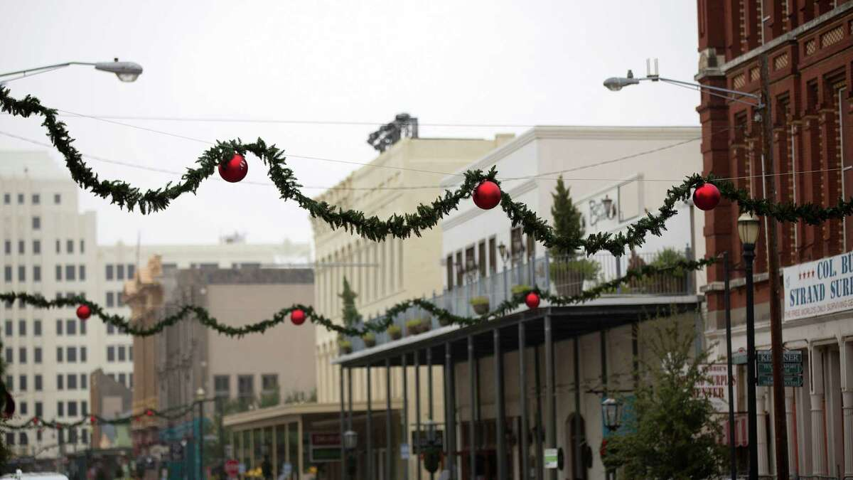 Garland and ornaments hang along The Strand as workers prepared for the 41st annual Dickens on the Strand Galveston's victorian holiday festival Thursday, Dec. 4, 2014, in Galveston. The event put on by the Galveston Historical Foundation, takes place December 5-7.