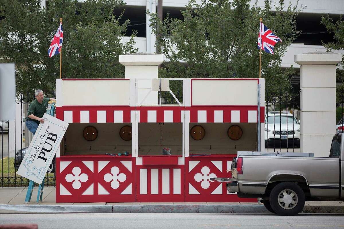 Tony Rubino with the Galveston Historical Foundation sets up one of the many portable pubs on Mechanic Avenue as workers prepared for the 41st annual Dickens on the Strand Galveston's victorian holiday festival Thursday, Dec. 4, 2014, in Galveston. The event put on by the Galveston Historical Foundation, takes place December 5-7.