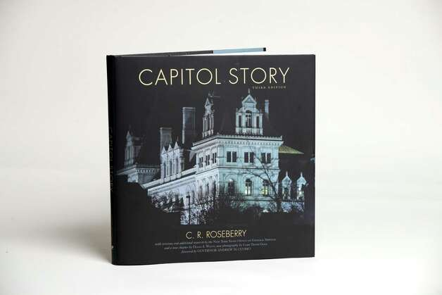 """Capitol Story,"" third edition by C.R. Roseberry Thursday, Dec. 4, 2014, at the Times Union in Colonie, N.Y. The third edition chronicles restoration work performed 1977-2013.  (Will Waldron/Times Union)"