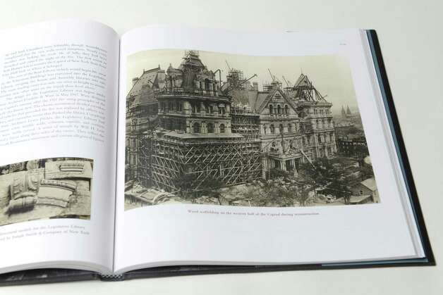 "Interior page of ""Capitol Story,"" third edition by C.R. Roseberry, shows reconstruction work following the fire of 1911 Thursday, Dec. 4, 2014, at the Times Union in Colonie, N.Y. The third edition chronicles recent restoration work performed 1977 and 2013.  (Will Waldron/Times Union)"