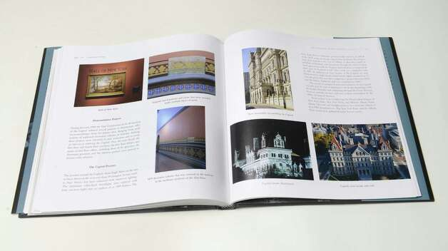 "Interior page of ""Capitol Story,"" third edition by C.R. Roseberry, shows the Capitol following some of the recent reconstruction work Thursday, Dec. 4, 2014, at the Times Union in Colonie, N.Y. The third edition chronicles recent restorations performed 1977 and 2013.  (Will Waldron/Times Union)"