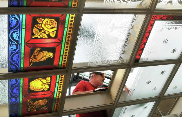 Glazier Stephen Dolan installs decorative glass panels in the laylight beneath the skylight above the Assembly staircase  at the Capitol in Albany Thursday Nov. 3, 2011.   (John Carl D'Annibale / Times Union) Photo: John Carl D'Annibale / 00015276A