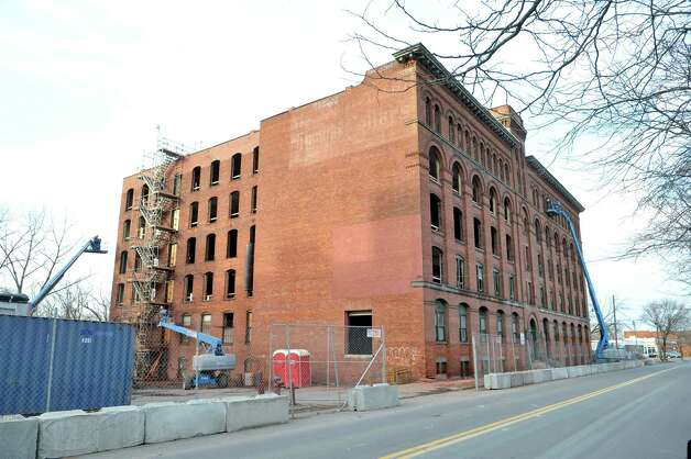 Work continues on the former Kelly Clothes building on River St. on Thursday, Dec. 4, 2014, in Troy, N.Y.   (Paul Buckowski / Times Union) Photo: Paul Buckowski / 00029749A