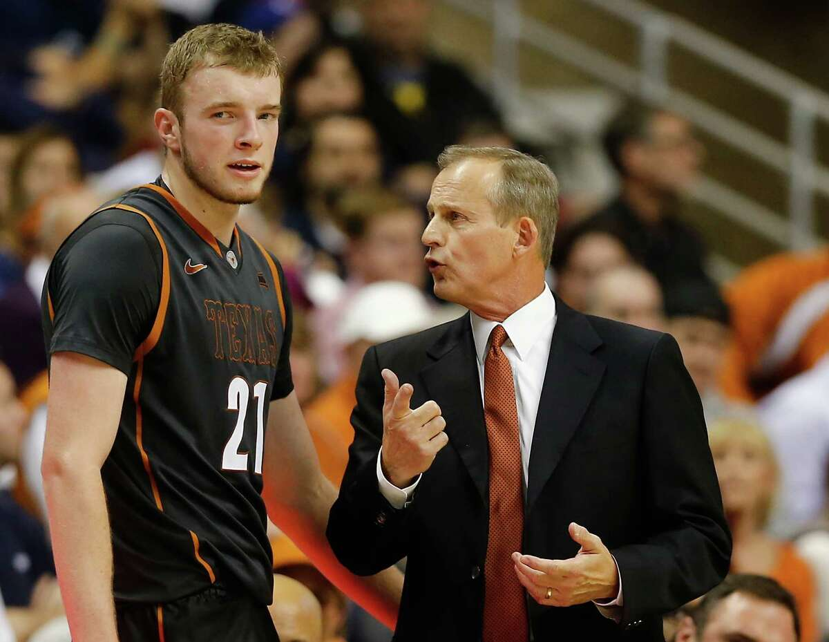 Coach Rick Barnes of the Texas Longhorns talks with Connor Lammert in the second half on the road against Connecticut Huskies on Nov. 30.