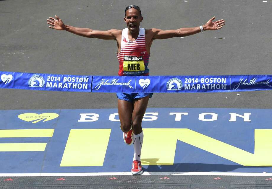 Meb Keflezighi wins the 118th Boston Marathon in April. He will be grand marshall of San Antonio's Rock 'n' Roll Marathon on Sunday. Photo: TIMOTHY A. CLARY / Getty Images / AFP