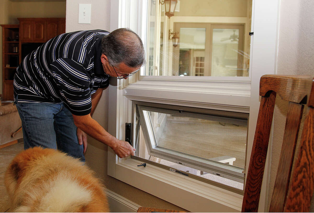 Louvered windows allow the dogs to see out at Dan and Mary Ellen Shook's house in Cordillera Ranch. They chose windows with blinds sandwiched between glass panes so they don't need window treatments, and they opted not to have window sills so the dogs won't jump up.